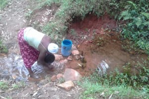 The Water Project: Imusutsu Community, Ikosangwa Spring -  Fetching Water
