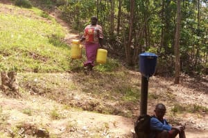 The Water Project: Shivembe Community, Murumbi Spring -  Coming To Fetch Water