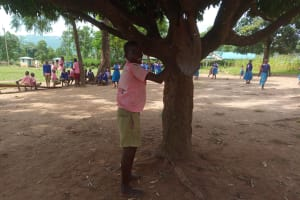 The Water Project: Kimangeti Primary School -  Student Ringing The School Bell