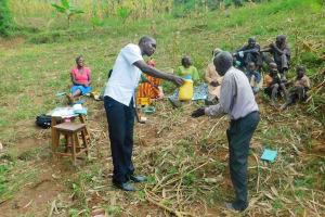The Water Project: Ngeny Barak Community, Ngeny Barak Spring -  Training On How To Build A Handwashing Station