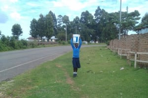 The Water Project: Kamimei Secondary School -  A Girl Returning From Fetching Extra Water From Home