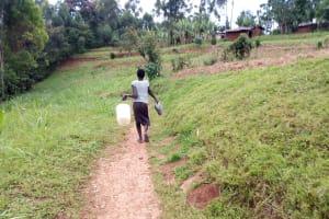 The Water Project: Bumavi Community, Joseph Njajula Spring -  Carrying Water