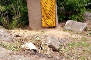 The Water Project: Bumira Community, Imbwaga Spring -  Mud Latrine