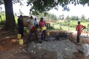 The Water Project: Shibinga Primary School -  Mixing Cement For Latrines