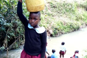 The Water Project: Kipchorwa Primary School -  Carrying Water