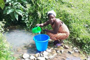 The Water Project: Buyangu Community, Osundwa Spring -  Fetching Water