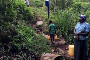 The Water Project: Chepnonochi Community, Shikati Spring -  Carrying Water