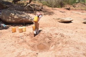 The Water Project: Kathonzweni Community -  Carrying Water