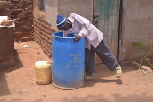 The Water Project: Kathonzweni Community -  Fetching Water From Container