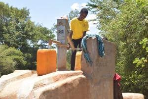 The Water Project: Ngitini Community D -  Filling Water At First Community Well