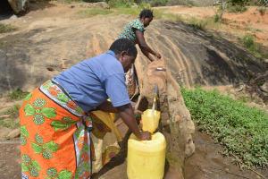 The Water Project: Wamwathi Community -  Fetching Water