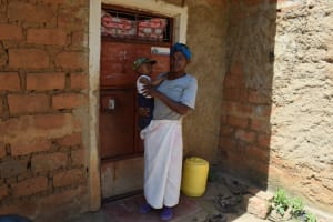 The Water Project: Kyamwao Community -  Christine Musyoka Stands In Front Of Her Home