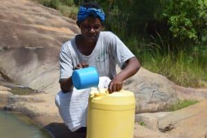 The Water Project: Kyamwao Community -  Fetching Water