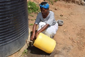 The Water Project: Kyamwao Community -  Filling From Rainwater Tank