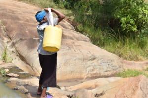 The Water Project: Kyamwao Community -  Hauling Water
