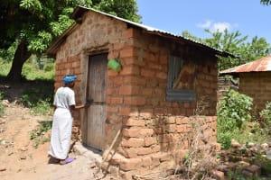 The Water Project: Kyamwao Community -  Walking Into Kitchen