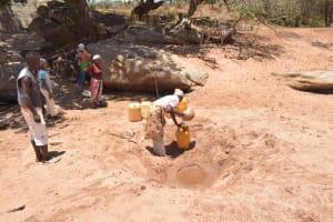 The Water Project: Kathonzweni Community A -  People Fetching Water