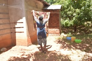 The Water Project: Ngitini Community E -  Hanging Clothes On The Line
