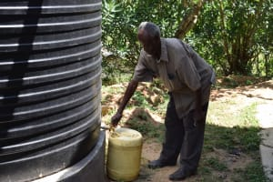 The Water Project: Kyamwao Community A -  Fetching Water From Tank