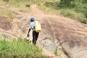 The Water Project: Kyamwao Community A -  Hauling Water