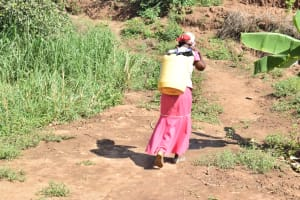 The Water Project: Kithumba Community E -  Carrying Water