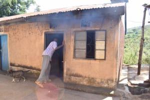 The Water Project: Kithumba Community E -  Closing Kitchen Door