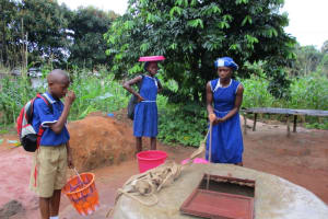 The Water Project: Mahera, SLMB Primary School -  Fetching Water At Open Well