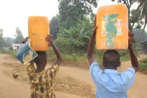 The Water Project: Mahera, SLMB Primary School -  People Carrying Water