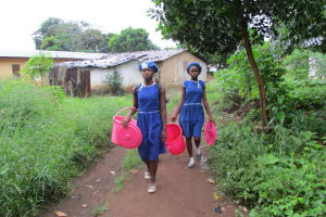 The Water Project: Mahera, SLMB Primary School -  Students Fetching Water
