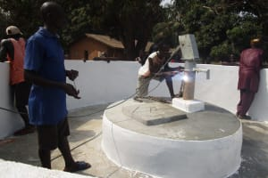 The Water Project: Lungi, Tonkoya Village -  Welding Chain To Pump Head
