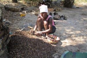 The Water Project: Lungi, Yaliba Village -  Woman Processing Palm Karnel