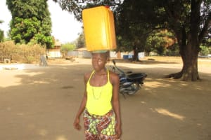The Water Project: Lungi, Tintafor, St. Lucia Well -  Carrying Water