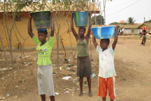 The Water Project: Lungi, 25 Maylie Lane -  Carrying Water