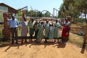 The Water Project: Lwanga Itulubini Primary School -  Students At School Gate