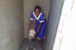 The Water Project: Musango Primary School -  Treating Latrine Using Ash