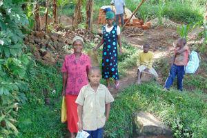 The Water Project: Bukhakunga Community, Mukomari Spring -  Bringing Materials To The Construction Site
