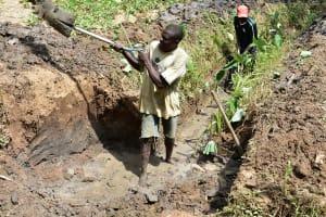 The Water Project: Emukoyani Community, Ombalasi Spring -  Community Members Helping Excavate