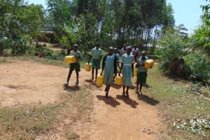 The Water Project: Lwanga Itulubini Primary School -  Going To Fetch Water