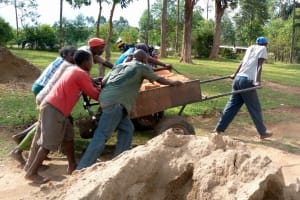 The Water Project: Ivumbu Primary School -  Bringing Bricks To The Construction Site