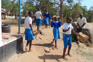 The Water Project: Lwakhupa Primary School -  Students Carrying Stones