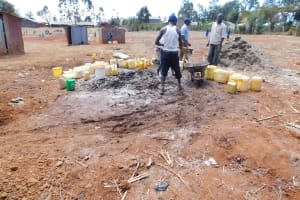 The Water Project: Sango Primary School -  Using Water That Students Delivered To Mix Cement