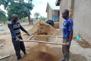 The Water Project: Lwakhupa Primary School -  Sifting Sand