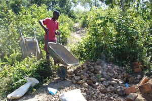 The Water Project: Mukoko Community, Mshimuli Spring -  Bringing Rocks To The Construction Site
