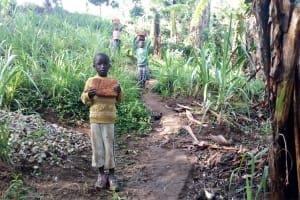 The Water Project: Bukhakunga Community, Mukomari Spring -  Carrying Bricks To The Site