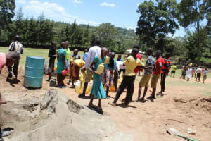 The Water Project: Koitabut Primary School -  Students Delivering Water For Us To Mix Cement