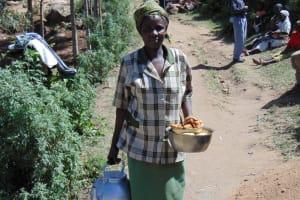 The Water Project: Imbinga Community, Arunga Spring -  Woman Bringing Food To Work Team