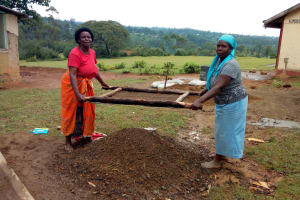 The Water Project: Ivumbu Primary School -  Sifting Sand