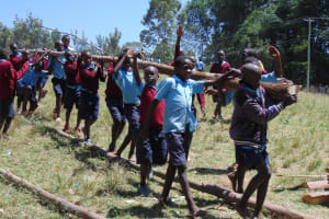 The Water Project:  Children Carrying Wood To The Construction Site
