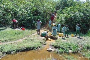The Water Project: Lwanga Itulubini Primary School -  Fetching Water