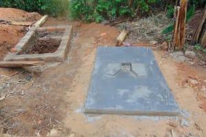 The Water Project: Ibinzo Community, Lucia Spring -  Sanitation Platform Drying